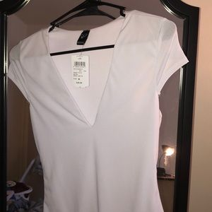 NWT low plunge bodysuit white